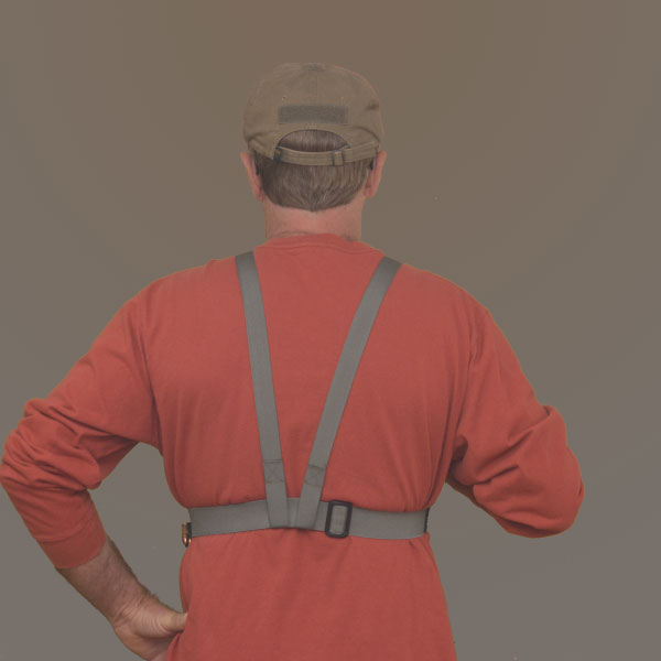 Image of man wearing chest holster from back.