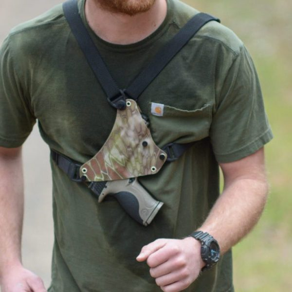 Chest holster shown on man running with XD9 weapon holstered.