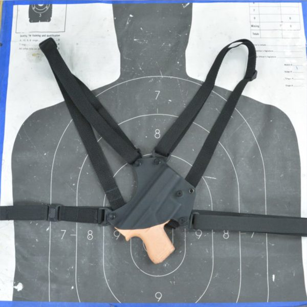 Chest Holster shown in black kydex with black straps, muzzle up.
