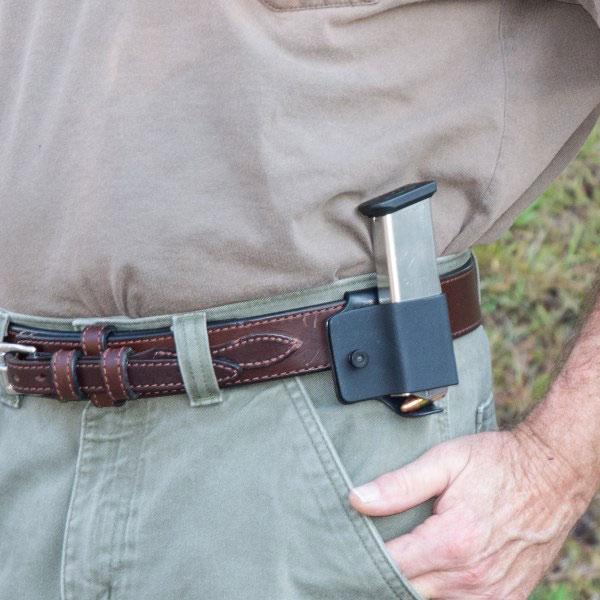 Man wearing gun belt with kydex mag pouches on belt.