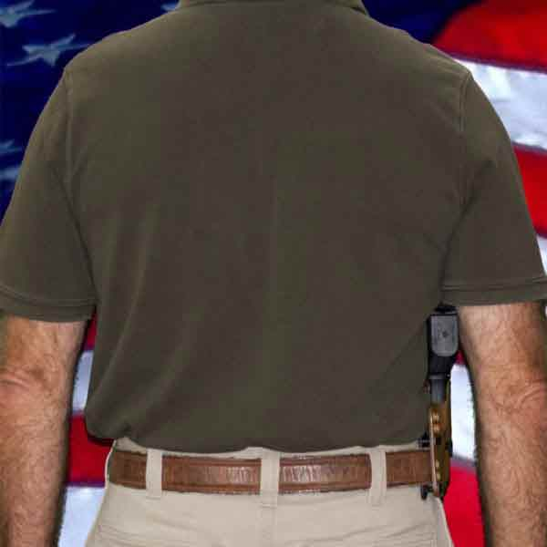 Man wearing the Pro S holster. View from the back showing snug fit.