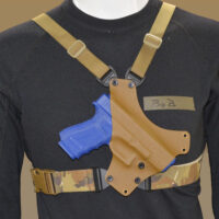 Chest holster shown with Multicam waist strap and coyote shoulder straps.