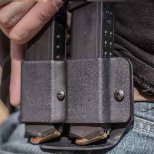Mag pouches shown in black on hip.