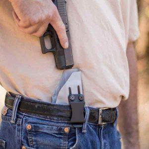 IWB,Inside the waistband holster shown on belt while reholstering.