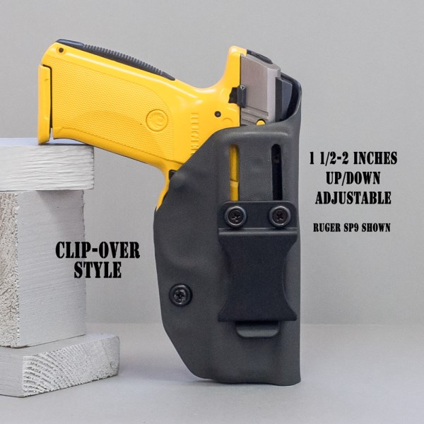 IWB holster (Inside the waistband holster) shown in black with yellow Ruger SR9