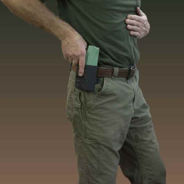 OWB Molle holster shown on belt with prop weapon.