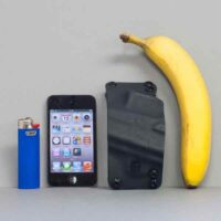 Pancake holster shown in black with lighter and ipod.