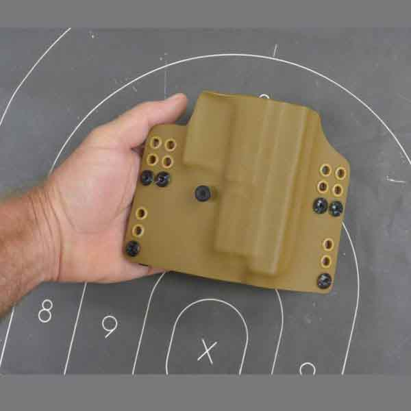 Outside the waistband holster shown from front.