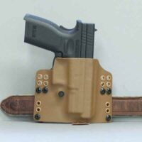 Pro S holster shown in coyote with weapon on belt.