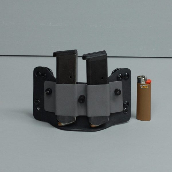 Double tactical mag pouch shown in black and gray with lighter for size comparison.