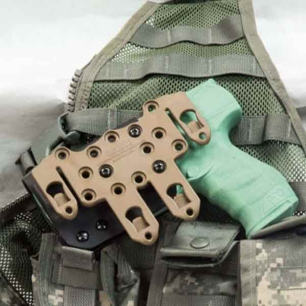 Molle holster shown with molle mount on tactical vest.