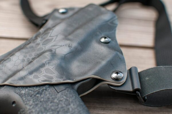 Black kydex chest holster close up photograph