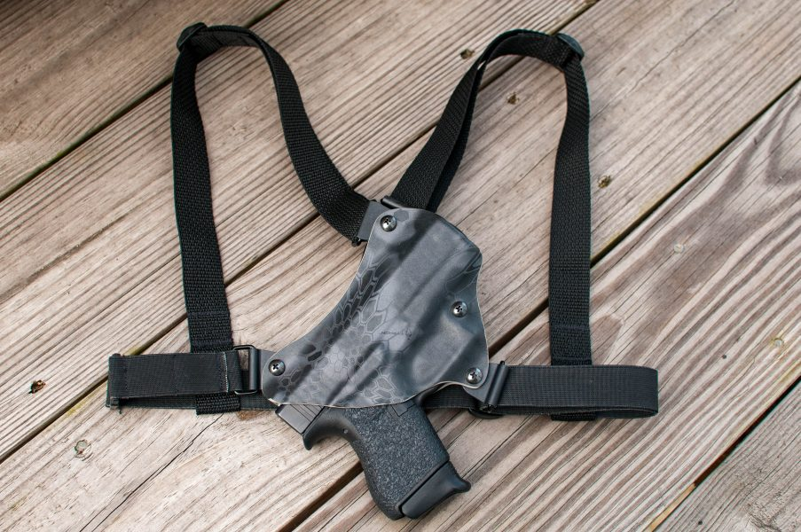 Black kydex chest holster with black straps.