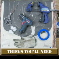 gloves, scissors, drill, clamp and tape on target background