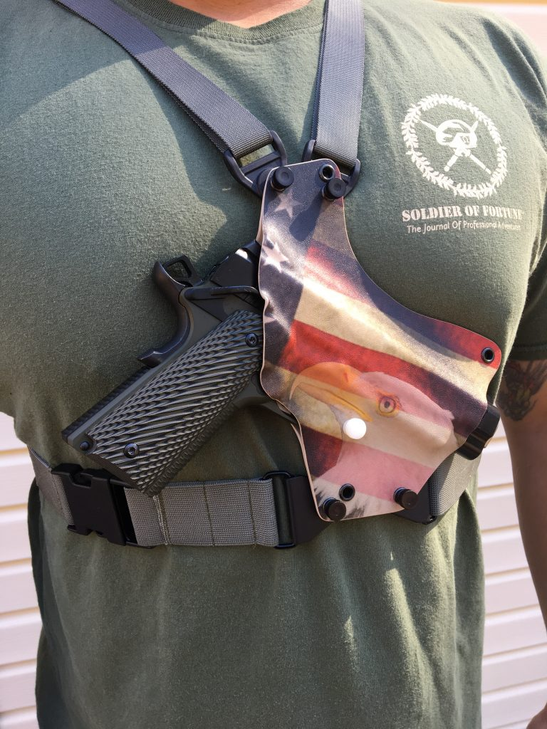 American flag kydex chest holster shown on man.